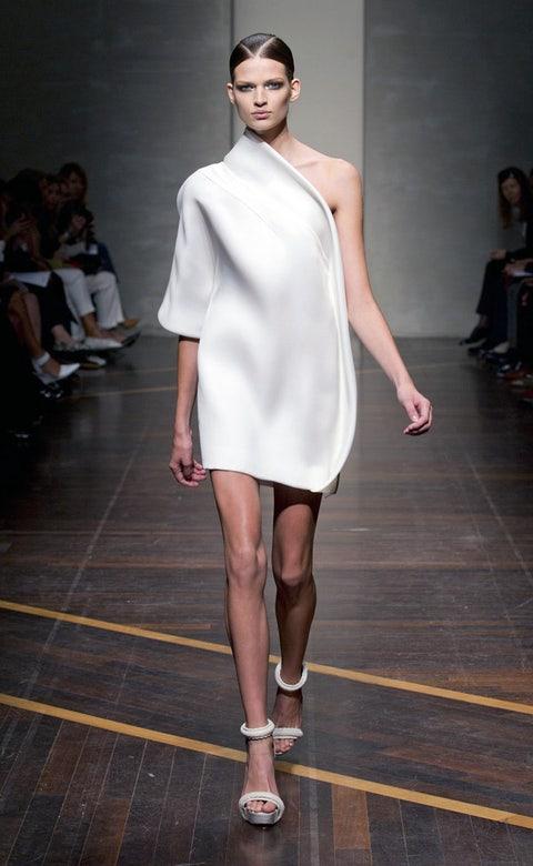 Footwear, Leg, Fashion show, Shoulder, Human leg, Joint, Runway, Fashion model, Style, Dress,