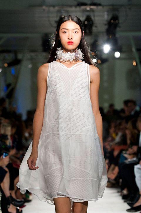 Fashion show, Shoulder, Joint, Dress, Runway, Style, Fashion model, One-piece garment, Fashion, Beauty,