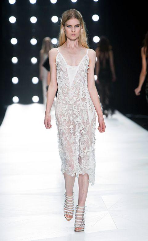Clothing, Fashion show, Shoulder, Human leg, Joint, Runway, Dress, Fashion model, Style, One-piece garment,