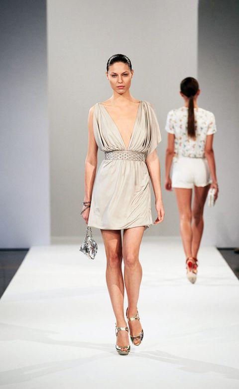 Clothing, Leg, Fashion show, Sleeve, Human leg, Shoulder, Runway, Joint, Waist, Fashion model,