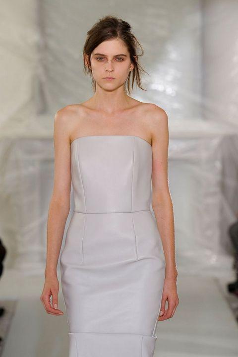 Hairstyle, Shoulder, Dress, Joint, Fashion show, Style, Waist, Fashion model, One-piece garment, Fashion,