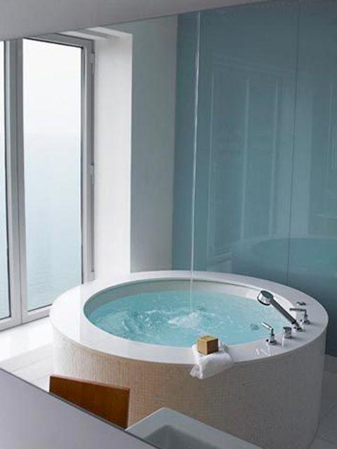 Fluid, Blue, Property, Liquid, Architecture, Teal, Aqua, Interior design, Turquoise, Wall,