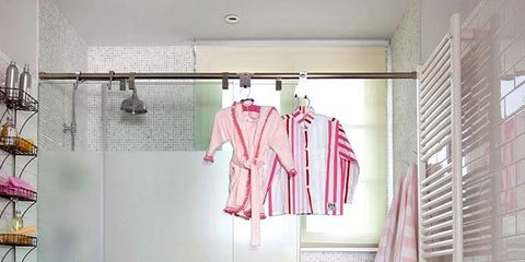 Room, Interior design, Floor, Wall, Flooring, Textile, Red, Pink, Clothes hanger, Interior design,