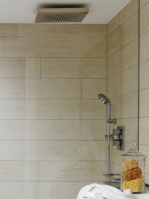 Wall, Room, Plumbing fixture, Tile, Plumbing, Beige, Composite material, Material property, Plumbing fitting, Bathroom accessory,