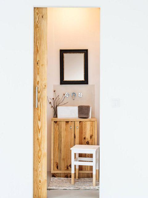 Furniture, Room, Door, Mirror, Wall, Table, Material property, Bathroom cabinet, Interior design, Bathroom accessory,