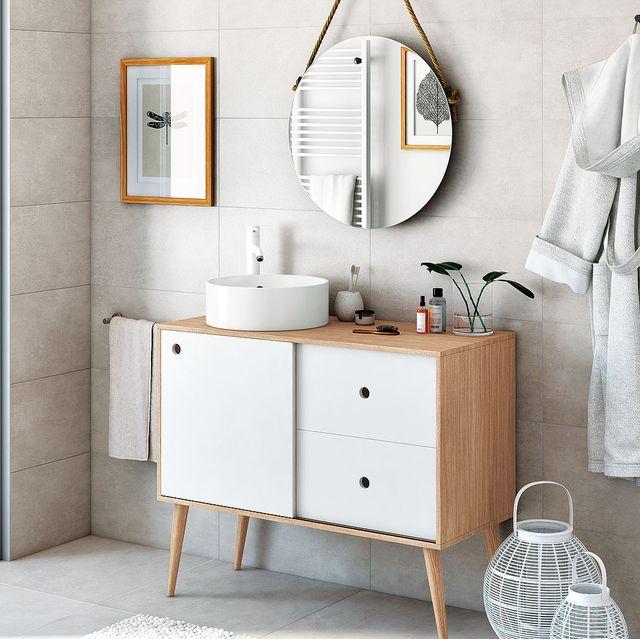 baño moderno con muebles de madera y lavabo redondo