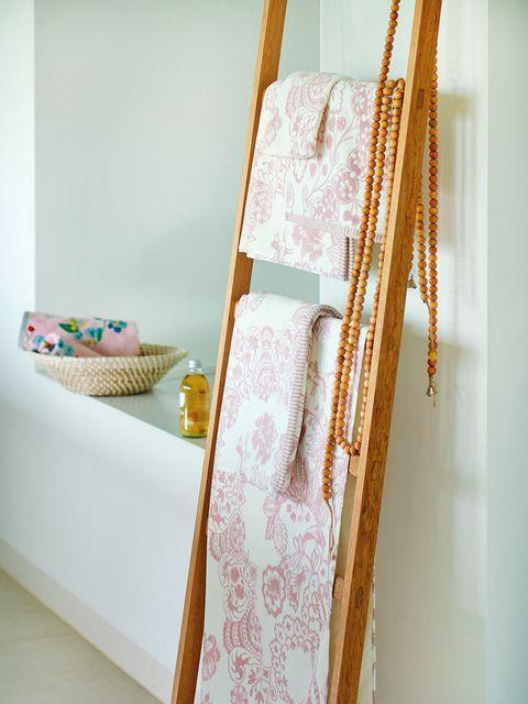 Textile, Room, Interior design, Linens, Creative arts, Peach, Craft, Pattern, Towel,