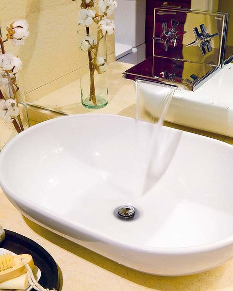 Plumbing fixture, Bathroom sink, Yellow, Fluid, Tap, Glass, Interior design, Sink, Bathroom accessory, Ceramic,