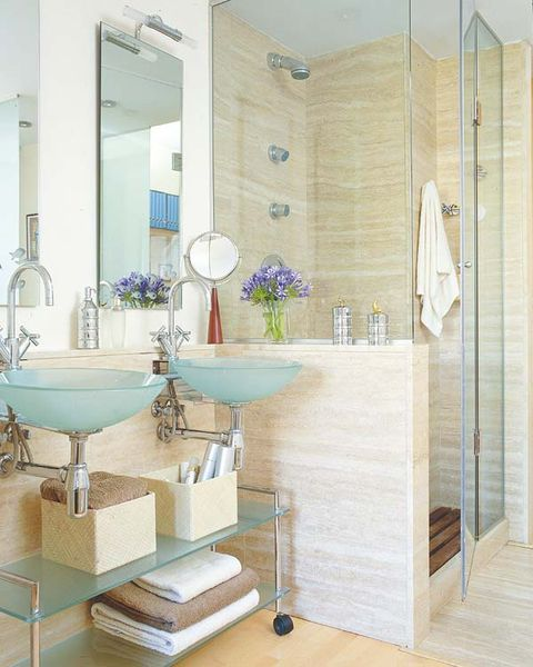 baño con ducha de obra mármol travertino