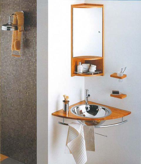 Wall, Mirror, Bathroom sink, Household hardware, Plumbing fixture, Sink, Still life photography, Tap, Brass, Handle,