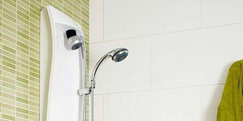Wall, Room, Plumbing fixture, Shower head, Household supply, Tile, Plumbing, Home accessories, Sweater, Shower panel,