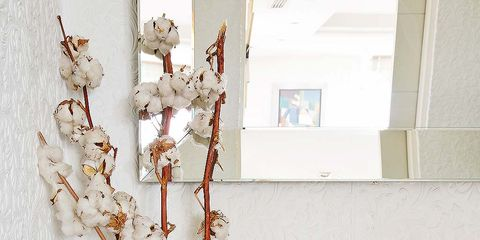 Branch, Twig, Interior design, Flowering plant, Still life photography, Basket, Artificial flower, Home accessories, Plant stem, Flowerpot,