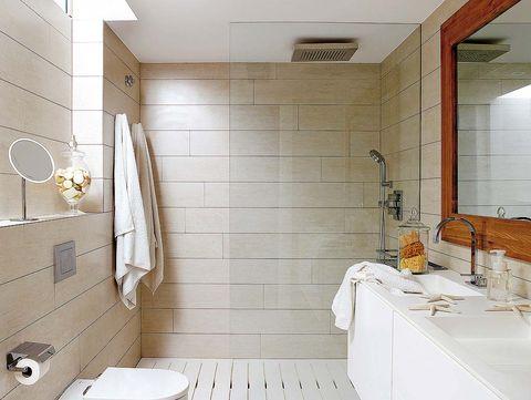 ducha a ras del suelo con rociador de techo