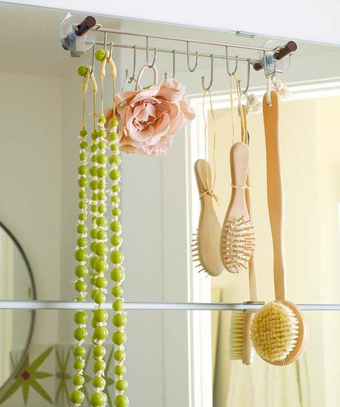 Clothes hanger, Yellow, Room, Curtain, Textile, Furniture, Baby mobile, Ceiling, Interior design,