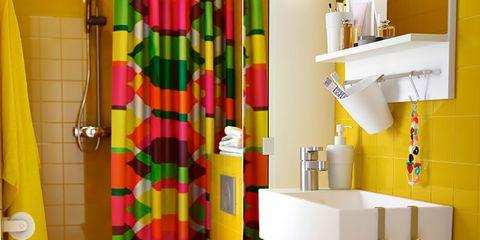 Yellow, Room, Interior design, Floor, Property, Flooring, Tile, Plumbing fixture, Wall, Shower curtain,