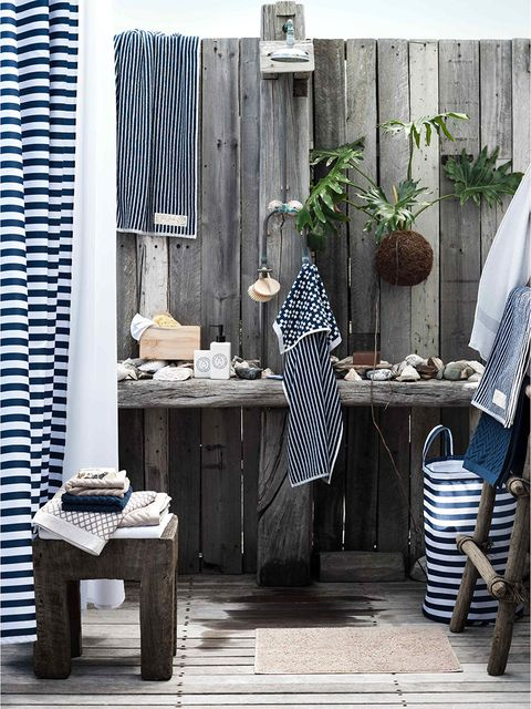 Blue, Table, Furniture, Flowerpot, Houseplant, Linens, End table, Flag, Desk, Home accessories,