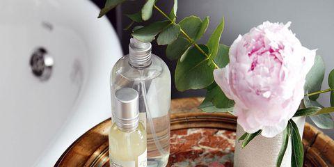 Petal, Pink, Liquid, Purple, Home accessories, Bottle, Linens, Centrepiece, Flowering plant, Glass bottle,
