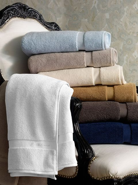 Textile, Cushion, Linens, Throw pillow, Grey, Pillow, Household supply, Towel, Home accessories, Armrest,
