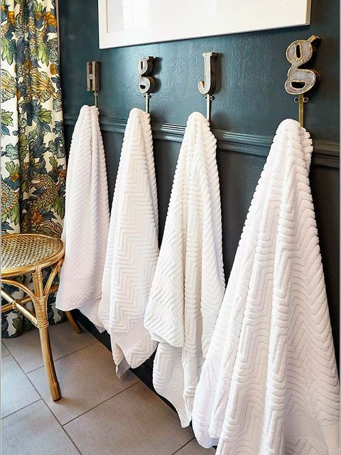 Textile, Room, Interior design, Linens, Grey, Teal, Home accessories, Metal, Towel, Household supply,