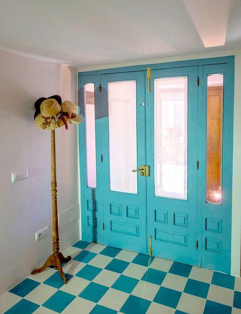 Floor, Wood, Room, Flooring, Interior design, Wall, Door, Ceiling, Teal, Turquoise,