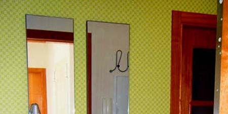 Door, Fixture, Home door, Wood stain, Door handle, Handle, Paint, Household hardware, Dead bolt, Varnish,