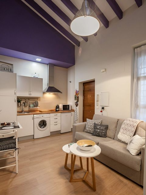 Room, Interior design, Floor, Furniture, Flooring, Light fixture, Ceiling, Couch, Living room, Ceiling fixture,