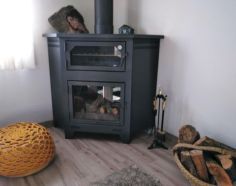 Wood-burning stove, Hearth, Heat, Room, Wood, Major appliance, Furniture, Fireplace, Stove, Floor,