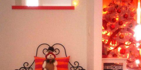 Lighting, Room, Interior design, Red, Toy, Christmas decoration, Interior design, Holiday, Decoration, Christmas ornament,