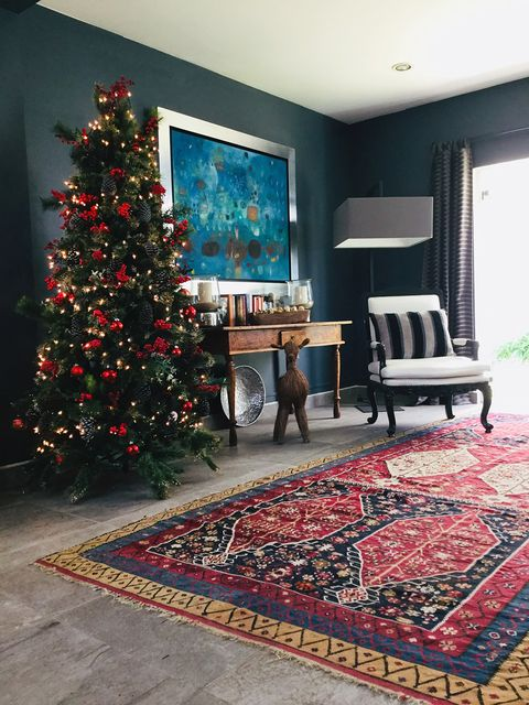 Room, Floor, Living room, Christmas tree, Carpet, Property, Interior design, Home, Christmas decoration, Flooring,