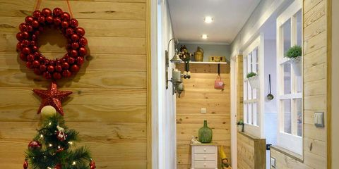 Christmas decoration, Event, Interior design, Floor, Room, Flooring, Red, Christmas ornament, Christmas tree, Interior design,