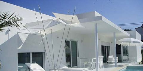 Swimming pool, Fluid, Property, Real estate, Shade, Sunlounger, House, Outdoor furniture, Roof, Composite material,