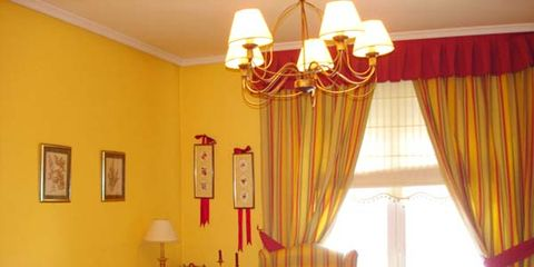 Interior design, Room, Yellow, Textile, Couch, Orange, Living room, Interior design, Window covering, Window treatment,
