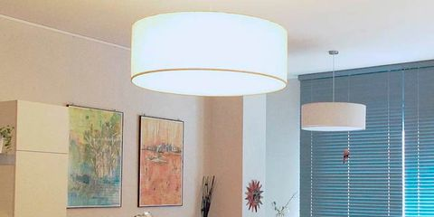 Living room, Furniture, Room, Interior design, Ceiling, Property, Lighting, Floor, Building, Yellow,