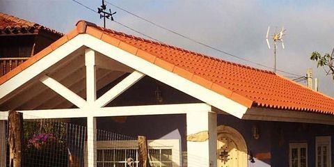 House, Roof, Door, Home, Cottage, Outdoor structure, Flowerpot, Landscaping,