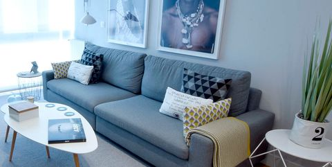 Furniture, Living room, Room, Couch, Blue, Interior design, Property, Sofa bed, studio couch, Table,