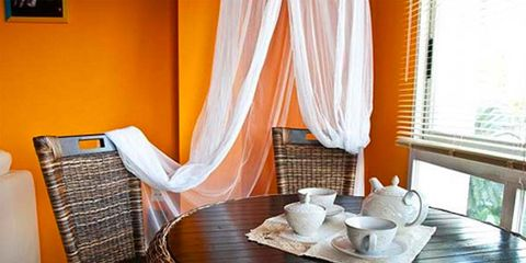 Wood, Interior design, Property, Room, Dishware, Furniture, Serveware, Table, Window covering, Floor,