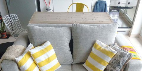Room, Interior design, Yellow, Living room, White, Couch, Furniture, Throw pillow, Wall, Pillow,