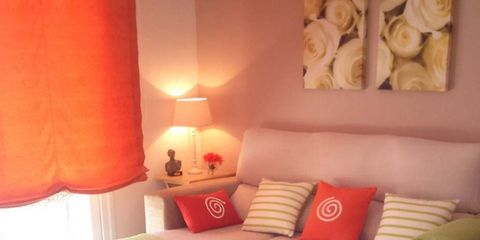 Interior design, Room, Lighting, Floor, Flooring, Living room, Furniture, Orange, Home, Wall,