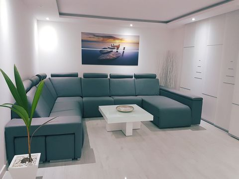 Room, Floor, Interior design, Green, Wall, Living room, Couch, Flooring, Ceiling, Furniture,