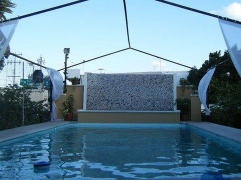 Blue, Property, Swimming pool, Fluid, Real estate, Azure, Composite material, Aqua, Shade, Water feature,