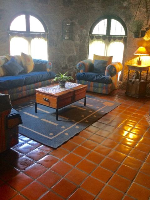 Lighting, Room, Interior design, Wood, Floor, Flooring, Couch, Furniture, Table, Wall,