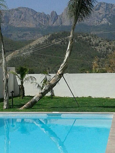 Nature, Fluid, Swimming pool, Mountainous landforms, Landscape, Mountain range, Mountain, Valley, Hill, Real estate,