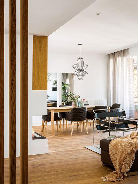 Room, Interior design, Living room, Furniture, Floor, Wood flooring, Property, Building, Laminate flooring, Table,