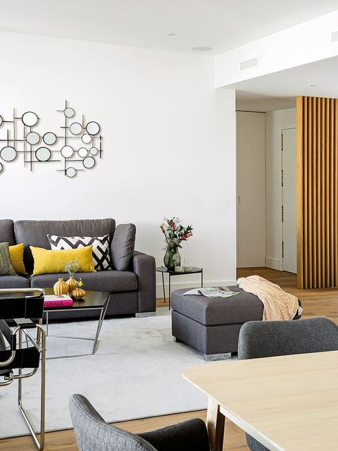 Living room, Room, Interior design, Furniture, Coffee table, Property, Yellow, Wall, Couch, Table,