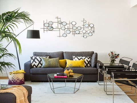 Living room, Furniture, Room, Interior design, Green, Wall, Yellow, Couch, Table, Purple,