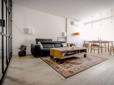 Living room, Room, Furniture, Interior design, Floor, Coffee table, Property, Table, Wall, Architecture,