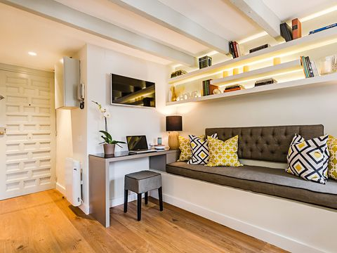 Room, Furniture, Interior design, Property, Ceiling, Shelf, Floor, Yellow, Wall, Living room,