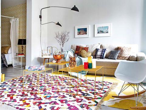 Room, Living room, Interior design, Floor, Furniture, Purple, Home, Wall, Table, Flooring,