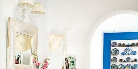 Room, Interior design, Flooring, Floor, Interior design, Teal, Picture frame, Creative arts, Flower Arranging, Cross,