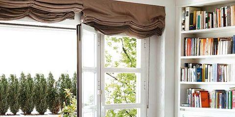 Room, Interior design, Wood, Furniture, Home, Interior design, Living room, Bookcase, Shelf, Orange,